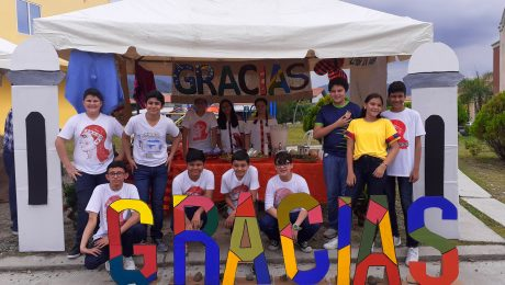 students representing a touristic part of Honduras by souvenirs and food.